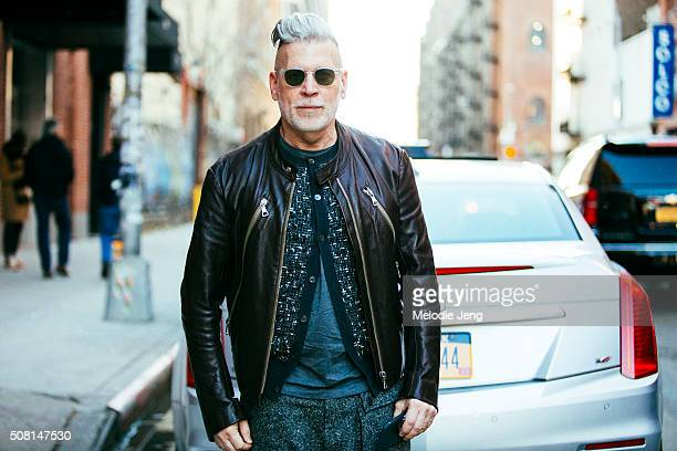 Nick Wooster wears a vintage leather jacket and Wooster Lardini top and pants seen at during New York Fashion Week Men's Fall/Winter 2016 on February...