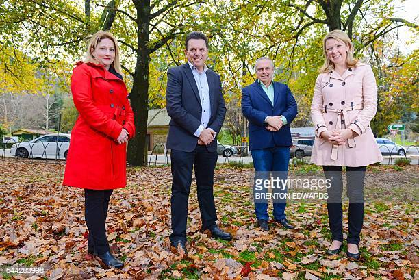 Nick Xenophon leader of the Nick Xenophon Team political party and his team candidates Rebekha Sharkie Skye KakoschkeMoore and Stirling Griff pose...