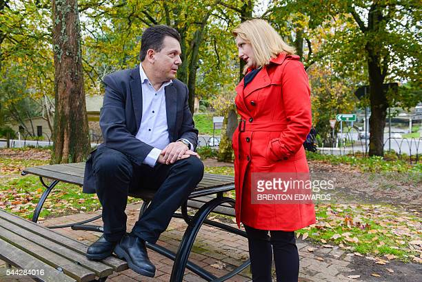 Nick Xenophon leader of the Nick Xenophon Team political party speaks with team candidate Rebekha Sharkie as they meet the press in the Adelaide...