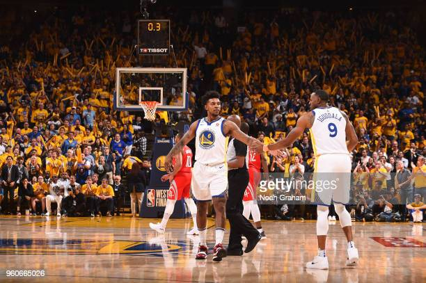 Nick Young and Andre Iguodala of the Golden State Warriors high five during the game against the Houston Rockets in Game Three of the Western...