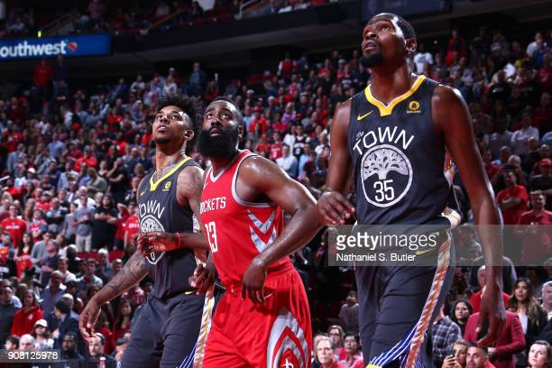 Nick Young and Kevin Durant of the Golden State Warriors and James Harden of the Houston Rockets react to a play during the game on January 20 2018...