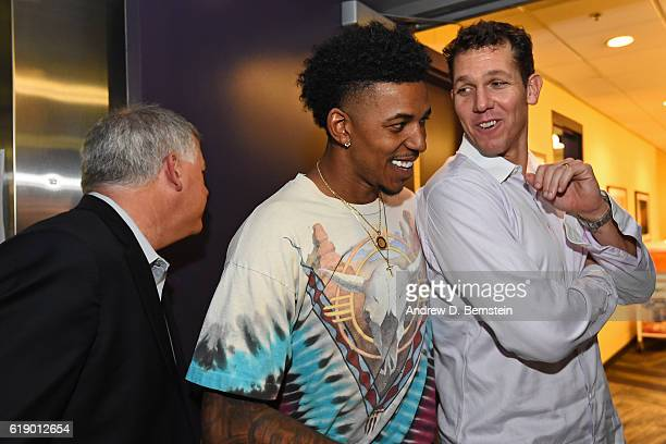 Nick Young and Luke Walton of the Los Angeles Lakers talk before the game against the Houston Rockets on October 26 2016 at STAPLES Center in Los...