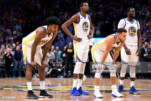 Nick Young Kevin Durant Stephen Curry and Draymond Green of the Golden State Warriors look on as the Denver Nuggets shoot a technical at Pepsi Center...