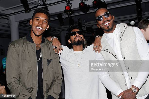 Nick Young Miguel and J R Smith attend Tim Coppens runway show during MADE Fashion Week Spring 2015 at Milk Studios on September 7 2014 in New York...