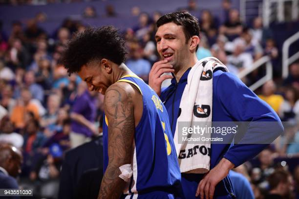 Nick Young of the Golden State Warriors and Zaza Pachulia of the Golden State Warriors look on during the game against the Phoenix Suns on April 8...