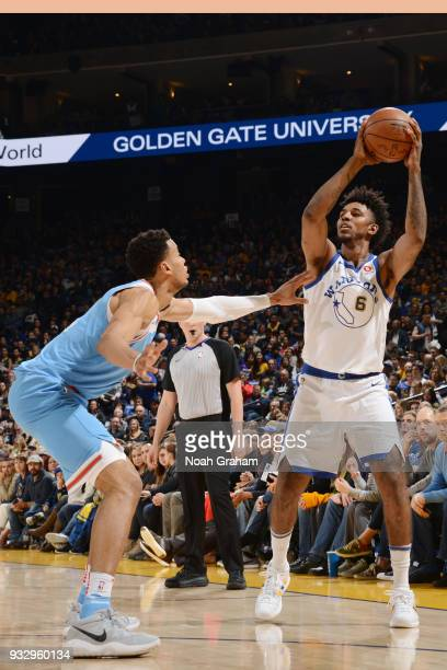 Nick Young of the Golden State Warriors handles the ball during the game against the Sacramento Kings on March 16 2018 at ORACLE Arena in Oakland...