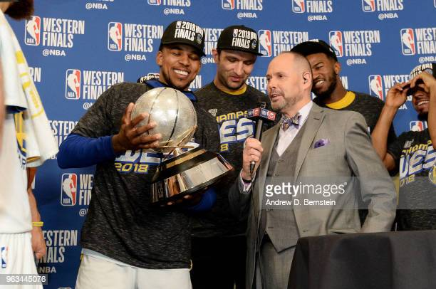 Nick Young of the Golden State Warriors holds the Western Conference Champion Trophy after the game against the Houston Rockets during Game Seven of...