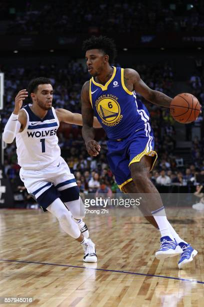 Nick Young of the Golden State Warriors in action against Tyus Jones of the Minnesota Timberwolves during the game between the Minnesota Timberwolves...