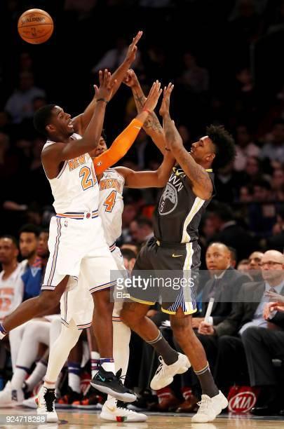 Nick Young of the Golden State Warriors passes the ball as Isaiah Hicks and Damyean Dotson of the New York Knicks defends at Madison Square Garden on...