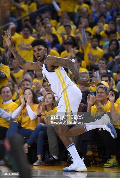 Nick Young of the Golden State Warriors reacts after making a threepoint shot over Dejounte Murray of the San Antonio Spurs in the fourth quarter...