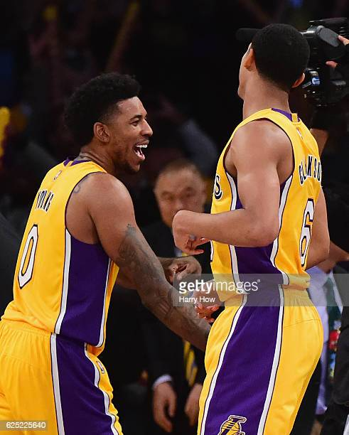 Nick Young of the Los Angeles Lakers celebrates a 111109 win over the Oklahoma City Thunder with Jordan Clarkson at Staples Center on November 22...