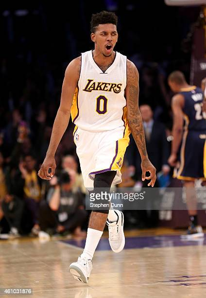Nick Young of the Los Angeles Lakers celebrates after stealing the ball and making a three point shot at the buzzer ending the second quarter against...
