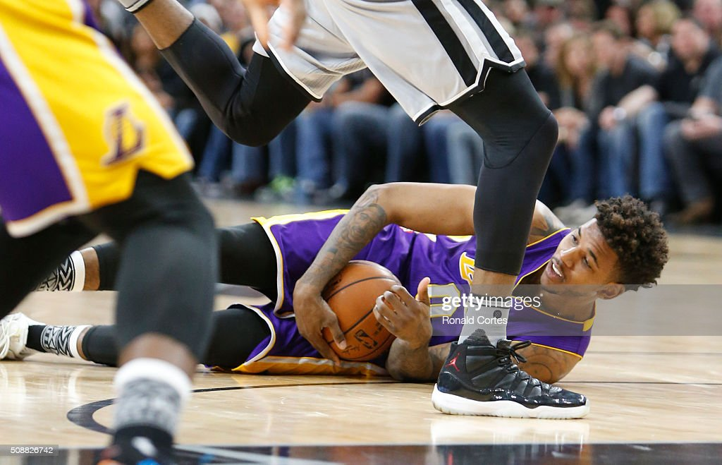 Nick Young #0 of the Los Angeles Lakers dives for a loose ball against the San Antonio Spurs at AT&T Center on February 6, 2016 in San Antonio, Texas.