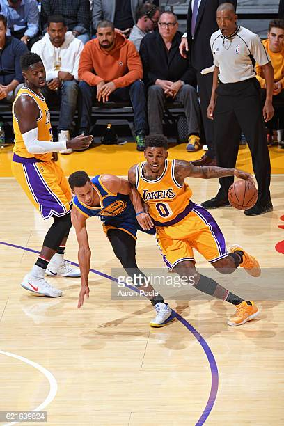 Nick Young of the Los Angeles Lakers dribbles the ball around Stephen Curry of the Golden State Warriors on November 4 2016 at STAPLES Center in Los...