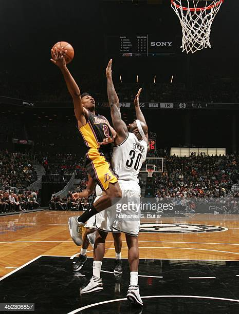 Nick Young of the Los Angeles Lakers goes up to shoot against Reggie Evans of the Brooklyn Nets during a game at Barclays Center on November 27 2013...