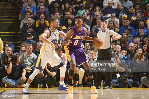 Nick Young of the Los Angeles Lakers handles the ball against the Golden State Warriors on November 23 2016 at ORACLE Arena in Oakland California...