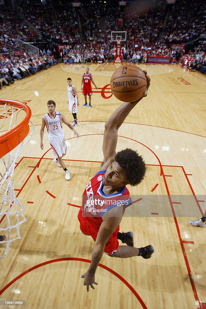 Nick Young #1 of the Philadelphia 76ers dunks the ball against the Houston Rockets on December 19, 2012 at the Toyota Center in Houston, Texas.