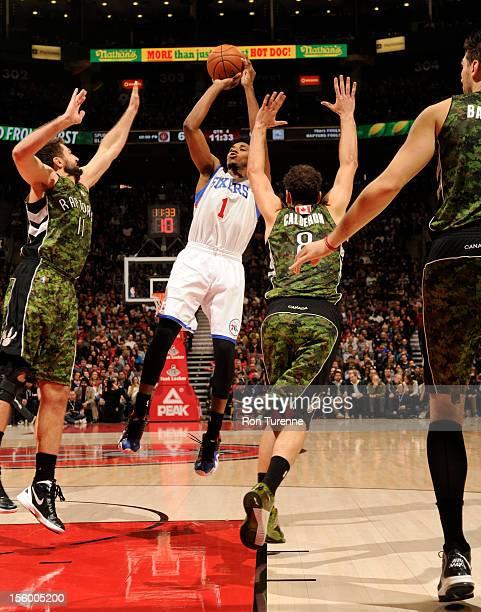 Nick Young of the Philadelphia 76ers shoots the ball over Linas Kleiza and Jose Calderon of the Toronto Raptors during the game on November 10 2012...