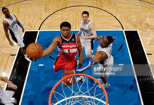Nick Young of the Washington Wizards goes to the basket against Dwight Howard of the Orlando Magic during the game on February 1 2012 at Amway Center...