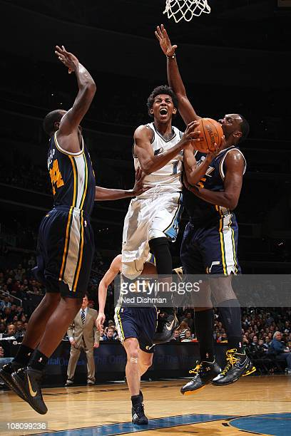 Nick Young of the Washington Wizards shoots against Paul Millsap and Al Jefferson of the Utah Jazz at the Verizon Center on January 17 2011 in...