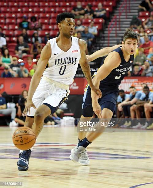 Nickeil AlexanderWalker of the New Orleans Pelicans brings the ball up the court against Grayson Allen of the Memphis Grizzlies during a semifinal...