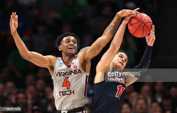 Nickeil AlexanderWalker of the Virginia Tech Hokies competes for the ball wtih Georgie PachecoOrtiz of the Liberty Flames in the second half during...