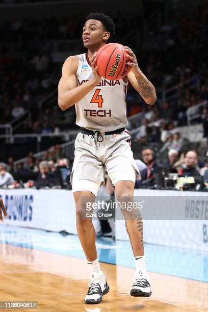 Nickeil AlexanderWalker of the Virginia Tech Hokies handles the ball in the first half against the Liberty Flames during the second round of the 2019...