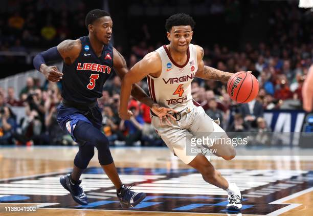 Nickeil AlexanderWalker of the Virginia Tech Hokies handles the ball against Lovell Cabbil Jr #3 of the Liberty Flames in the first half during the...