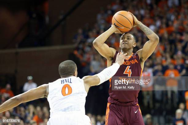 Nickeil AlexanderWalker of the Virginia Tech Hokies shoots over Devon Hall of the Virginia Cavaliers in the first half during a game at John Paul...