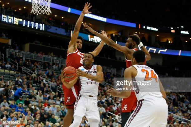 Nickeil AlexanderWalker of the Virginia Tech Hokies shoots the ball against Braxton Key of the Alabama Crimson Tide during the second half of the...