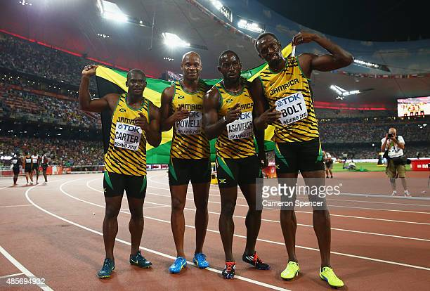 Nickel Ashmeade of Jamaica Asafa Powell of Jamaica Usain Bolt of Jamaica of Jamaica and Nesta Carter of Jamaica celebrate after winning gold in the...