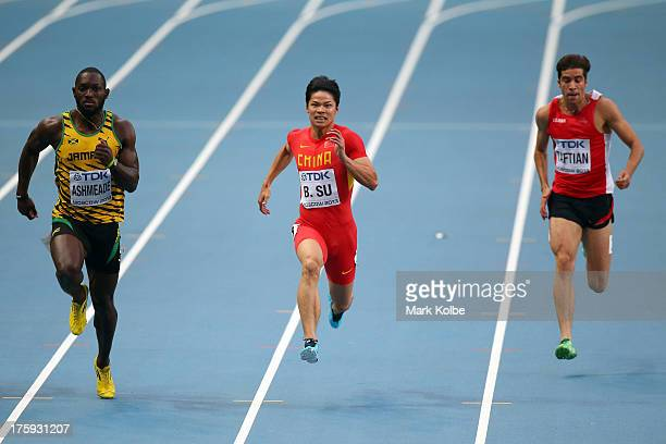 Nickel Ashmeade of Jamaica Bingtian Su of China and Hassan Taftian of Iran compete in the Men's 100 metres heats during Day One of the 14th IAAF...