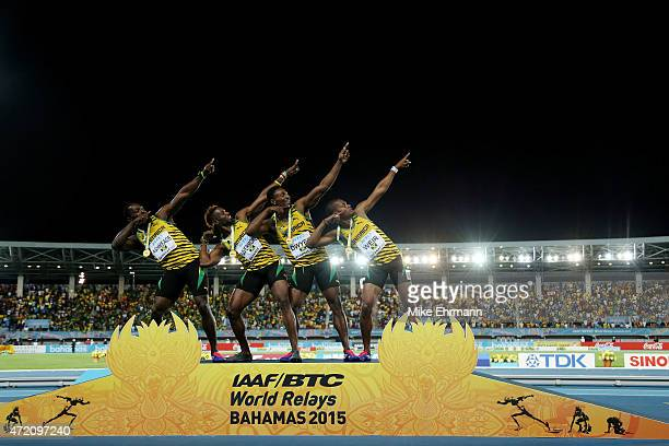 Nickel Ashmeade Rasheed Dwyer Jason Livermore and Warren Weir of Jamaica celebrate after winning the final of the men's 4 x 200 metres relay on day...