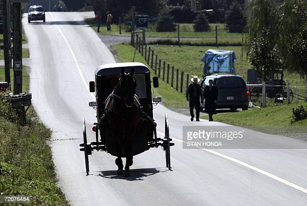 An Amish horse and buggy goes down a road near the oneroom West Nickel Mines Amish School 03 October 2006 in the town of Nickel Mines near Lancaster...