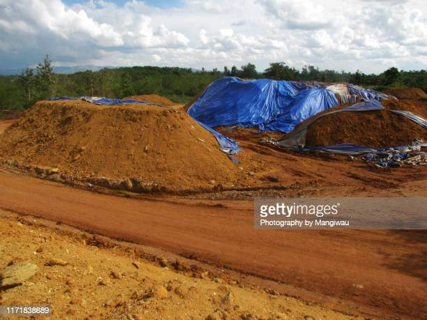 nickel ore stockpile - tarpaulin stock pictures, royalty-free photos & images