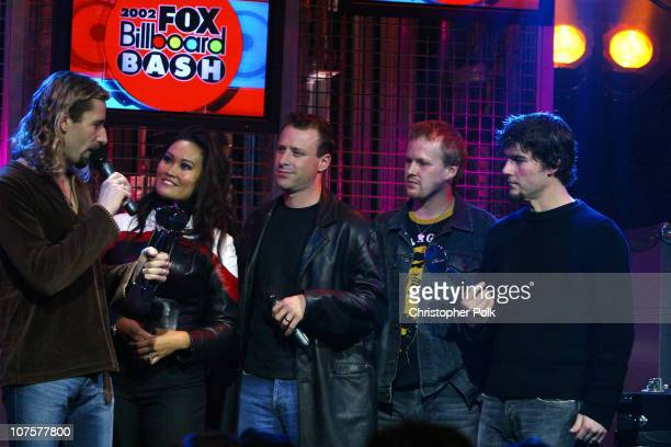 Nickelback and Tia Carrere during 2002 Fox Billboard Bash Show and Party at Studio 54 inside MGM Grand Casino in Las Vegas NV