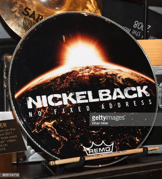 Nickelback drummer Daniel Adair's bass drum head is displayed in a memorabilia case after it was unveiled ahead of the band's fivenight 'Feed the...
