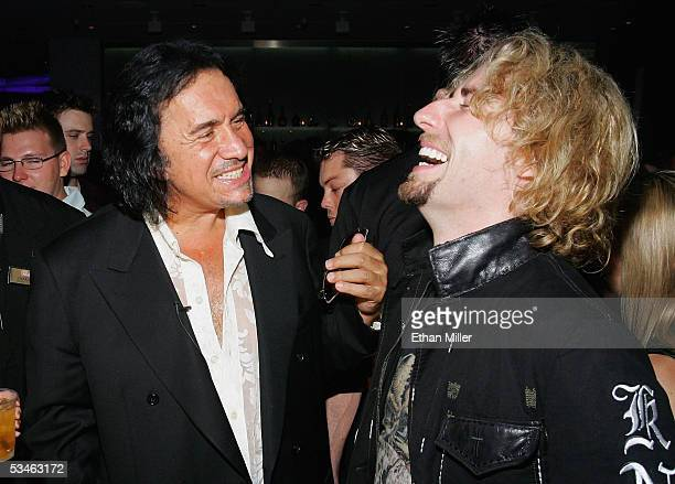 Nickelback frontman Chad Kroeger shares a laugh with Kiss singer/bassist Gene Simmons during Simmons' birthday party at the Ghostbar at the Palms...