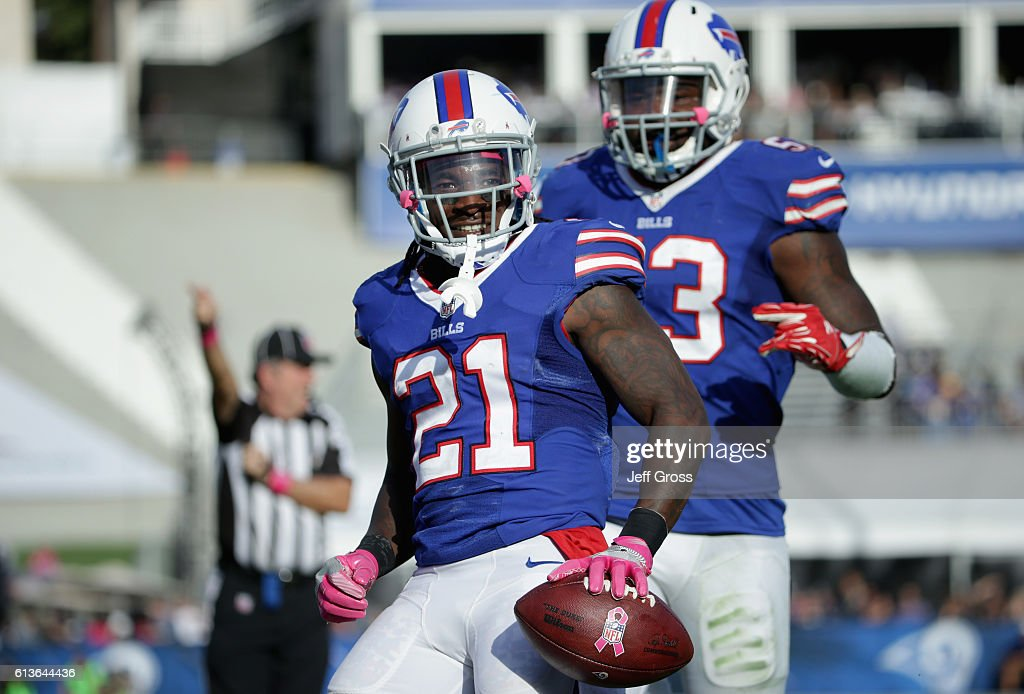 Nickell Robey #21 of the Buffalo Bills celebrates his interception with teammate Zach Brown #53 in the fourth quarter of the game at the Los Angeles Memorial Coliseum on October 9, 2016 in Los Angeles, California.