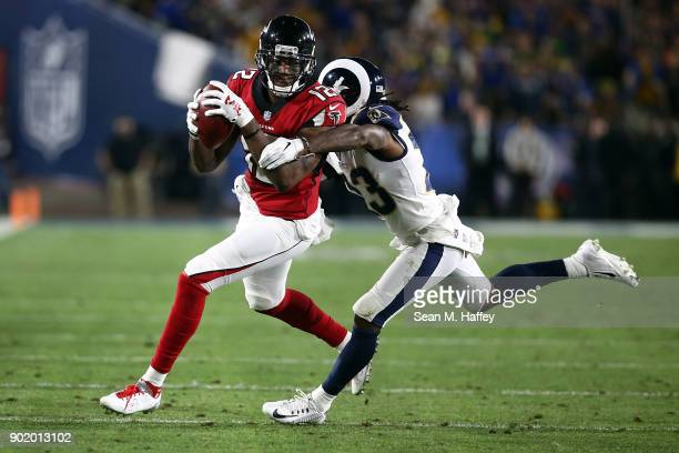 Nickell RobeyColeman of the Los Angeles Rams directs Mohamed Sanu of the Atlanta Falcons out of bounds after making the catch during the NFC Wild...