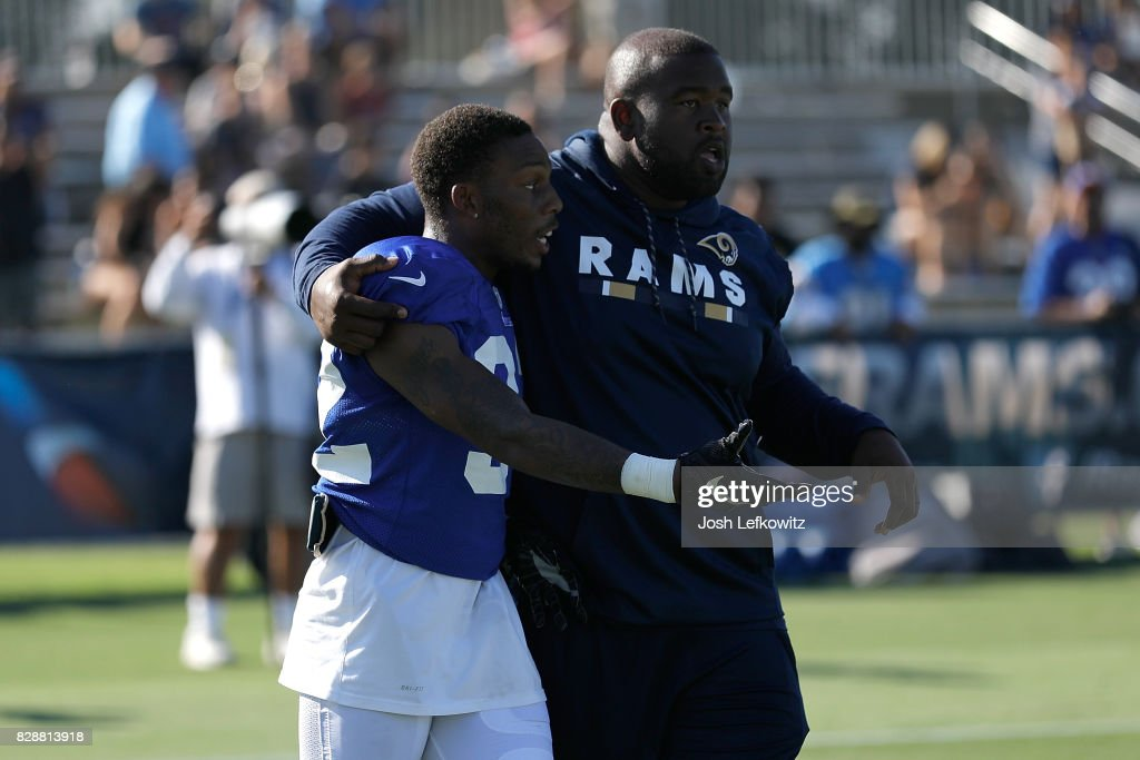 Nickell Robey-Coleman #23 of the Los Angeles Rams is escorted to the sidelines after a fight breaks out during a combined practice with the Los Angeles Chargers at Crawford Field on August 9, 2017 in Irvine, California.