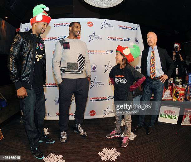 Nickelodeon actor Chico Benymon Los Angeles Clippers' Chris Paul and LA's Best' Gerald L Katell talk with a young participant during AEG's Season of...