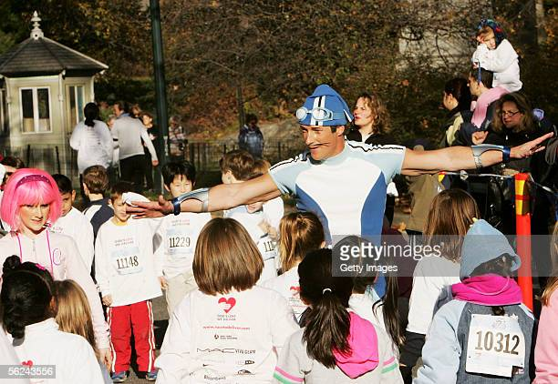 Nickelodeon's Sportacus and Stephanie help children stretch during Lazy Town Race in Central Park on November 20 2005 in New York City