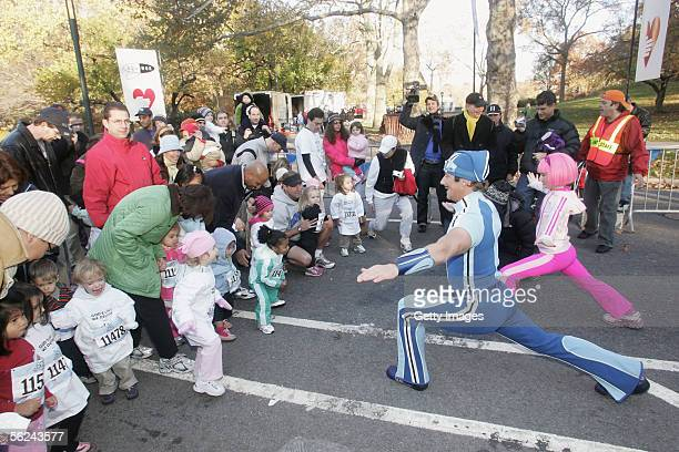 Nickelodeon's Sportacus and Stephanie help runners stretch during Lazy Town Race in Central Park on November 20 2005 in New York City