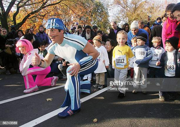 Nickelodeon's Sportacus and Stephanie run in Lazy Town Race In Central Park on November 20 2005 in New York City