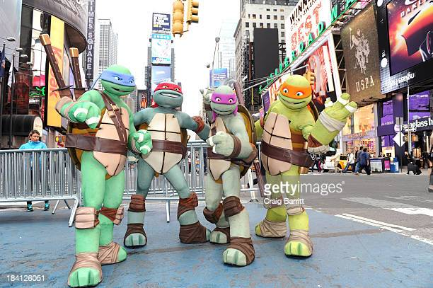 Nickelodeon's Teenage Mutant Ninja Turtles appear on VH1's Big Morning Buzz show at Times Square New York on October 11 2013 in New York City