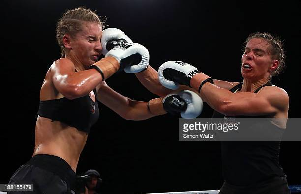 Nicki Bigwood lands a pucnh to the head of Lauryn Eagle during a womans lightweight undercard bout before the bout between David Tua and Alexander...