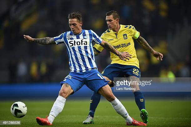 Nicki Bille Nielsen of Esbjerg fB and Daniel Agger of Brondby IF compete for the ball during the Danish Alka Superliga match between Brondby IF and...