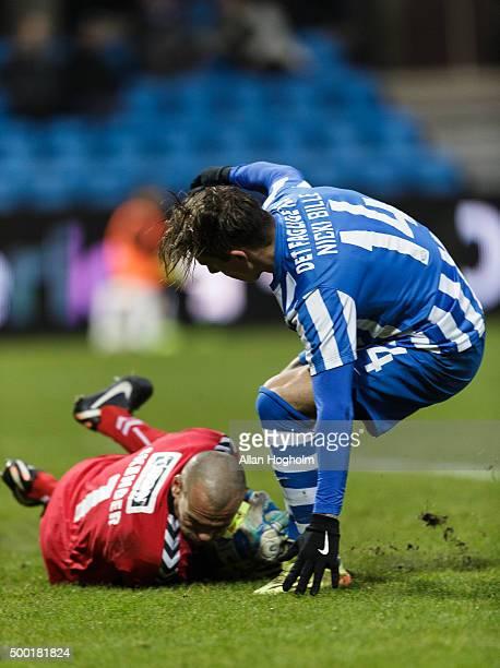 Nicki Bille Nielsen of Esbjerg fB and Goalkeeper Marin Skender of SonderjyskE compete for the ball during the Danish Alka Superliga match between...