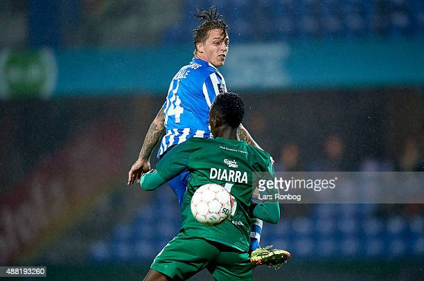 Nicki Bille Nielsen of Esbjerg fB and Mohammed Diarra of OB Odense compete for the ball during the Danish Alka Superliga match between Esbjerg fB and...